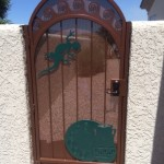 side gate with green designs on screen door image