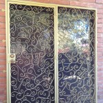 yellow spiral design double screen door image