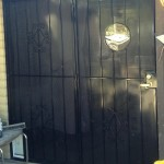 black screen door with spiral design image