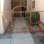 brown enclosure and gate with spiral design image