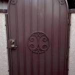 arched side gate door with spiral design image