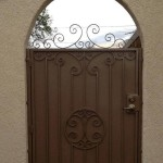 brown side gate door arched with spirals design image