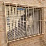 metal window guard tan with design image