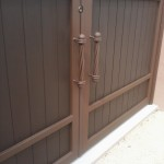 wood and steel double doors with handles image