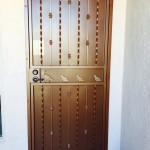 brown screen door with quail design image