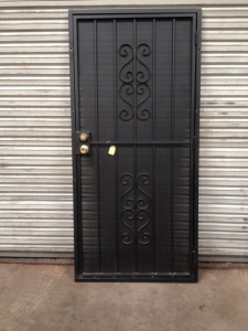 "outside frame measures 38 "" x 81"" Black scroll design (#103 in our catalog). Door is sold 'AS IS' for $300.00, more than 50% off."