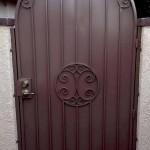 arched side gate door with spiral design image