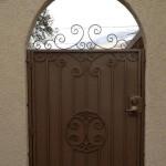 brown side gate door arched with spirals design image