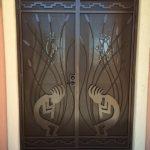 brown custom security screen door with kokopelli design image